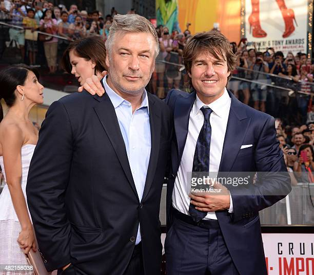 Alec Baldwin and Tom Cruise attend the New York premiere of 'Mission Impossible Rogue Nation' at Times Square on July 27 2015 in New York City