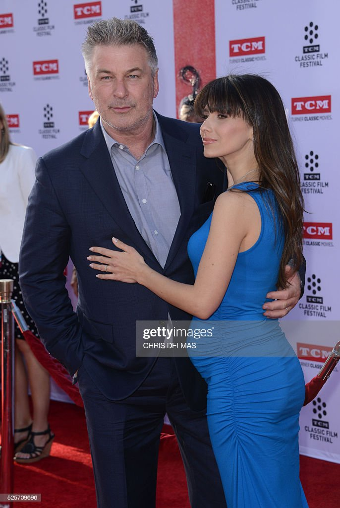 Alec Baldwin and wife Hilaria attend the Opening Night Gala of the 2016 TCM Classic Film Festival celebrating The 40th Anniversary Screening of ALL THE PRESIDENT��S MEN at the Chines Theatre in Hollywood, California, on April 28, 2016. / AFP / CHRIS