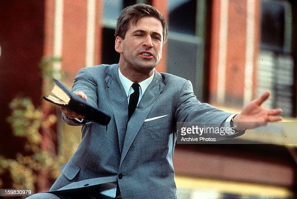 Alec Baldwin holds a book in a scene from the film 'Great Balls Of Fire' 1989