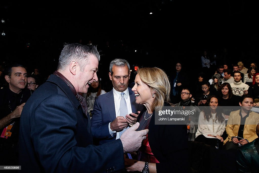 Alec Baldwin John Molner and Katie Couric attend Carmen Marc Valvo during MercedesBenz Fashion Week Fall 2015 at The Theatre at Lincoln Center on...