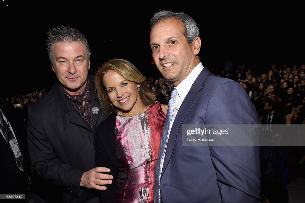 Alec Baldwin Katie Couric and John Molner attend Carmen Marc Valvo fashion show during MercedesBenz Fashion Week Fall 2015 at The Theatre at Lincoln...
