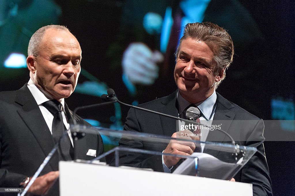 Alec Baldwin (R) looks on as New York Police Department commissioner Raymond W. Kelly speaks on stage during the New Yorker For New York Gala 2013 at Gotham Hall on February 25, 2013 in New York City.
