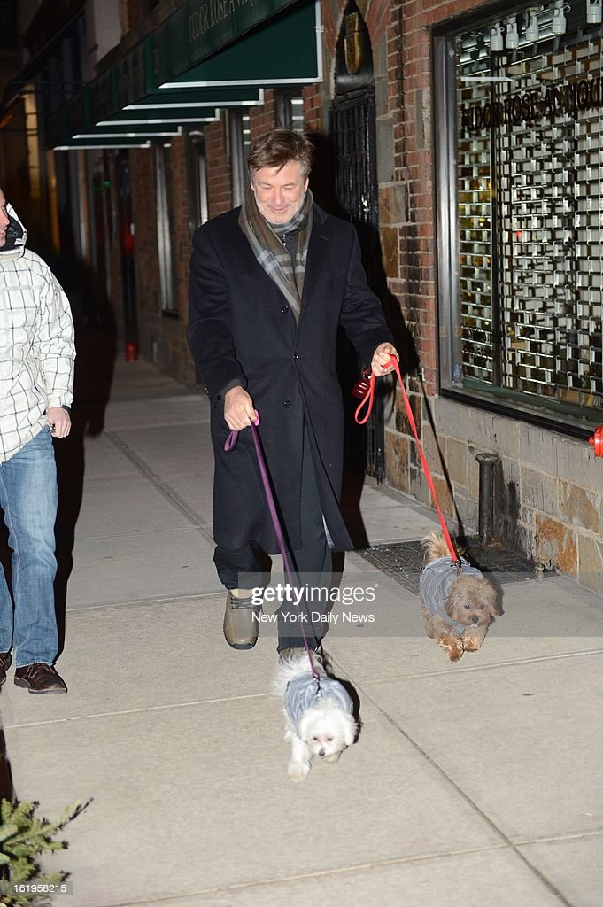Alec Baldwin takes his dogs for a walk in the Village Sunday night.