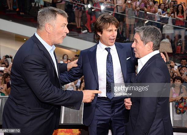 Alec Baldwin Tom Cruise and Chairman and CEO of Paramount Pictures Brad Grey attend the New York premiere of 'Mission Impossible Rogue Nation' at...