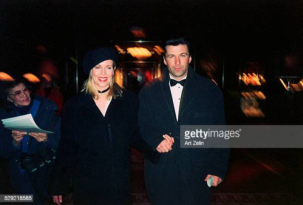 Alec Baldwin with Kim Basinger walking together holding hands circa 1990 New York
