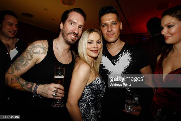 Alec 'Boss Burns' Voelkel Regina Halmich and Richard Kruspe Bernstein attend the Echo Awards 2012 party at Palais am Funkturm on March 22 2012 in...