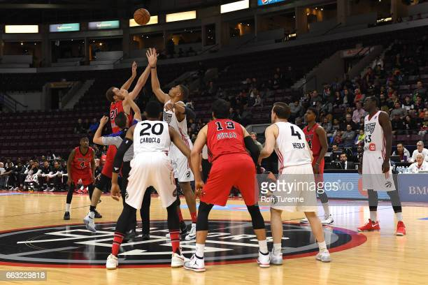 Alec Brown of the Windy City Bulls and Edy Tavares of the Raptors 905 go up for the opening tip off on March 30 2017 in Mississauga Ontario Canada...