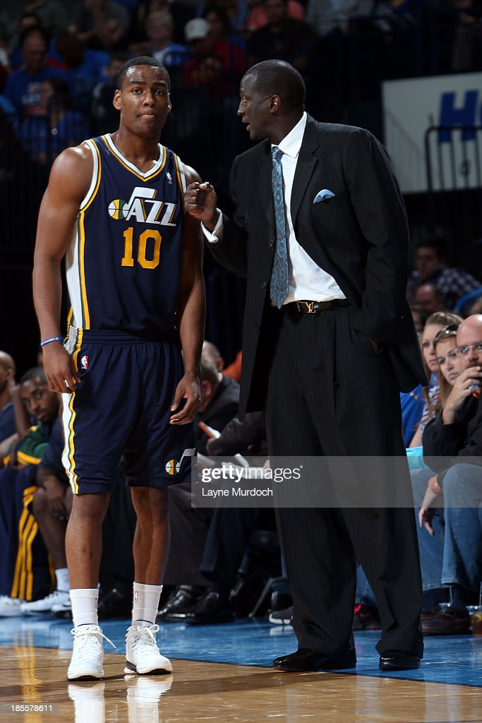 Alec Burks #10 and Tyrone Corbin of the Utah Jazz talk during the game against the Oklahoma City Thunder during an NBA preseason game on October 20, 2013 at the Chesapeake Energy Arena in Oklahoma City, Oklahoma.
