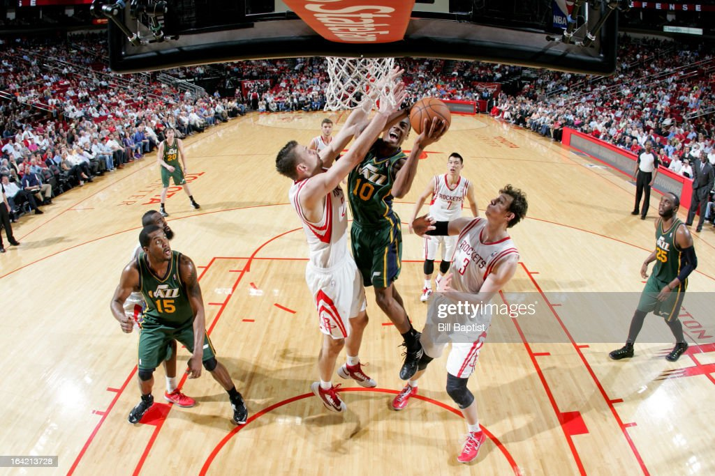 <a gi-track='captionPersonalityLinkClicked' href=/galleries/search?phrase=Alec+Burks&family=editorial&specificpeople=6834208 ng-click='$event.stopPropagation()'>Alec Burks</a> #10 of the Utah Jazz attempts a shot against <a gi-track='captionPersonalityLinkClicked' href=/galleries/search?phrase=Donatas+Motiejunas&family=editorial&specificpeople=5561687 ng-click='$event.stopPropagation()'>Donatas Motiejunas</a> #20 of the Houston Rockets on March 20, 2013 at the Toyota Center in Houston, Texas.