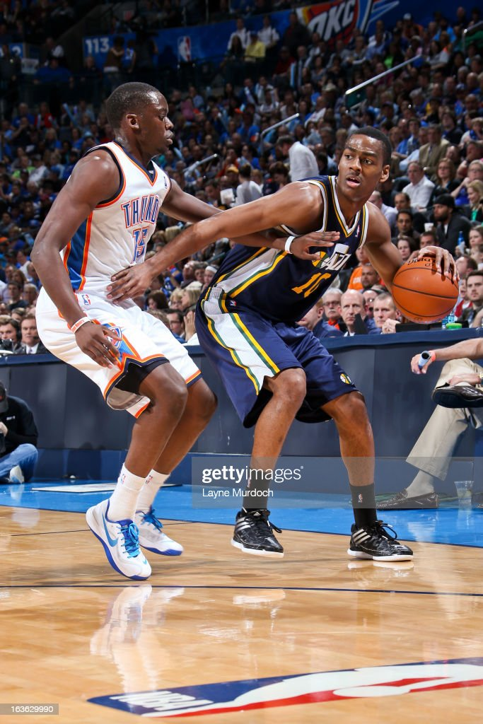 Alec Burks #10 of the Utah Jazz controls the ball against Reggie Jackson #15 of the Oklahoma City Thunder on March 13, 2013 at the Chesapeake Energy Arena in Oklahoma City, Oklahoma.