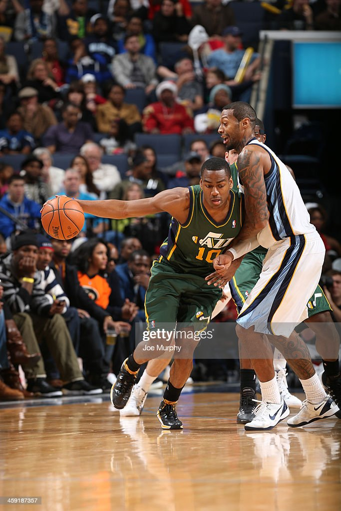 Alec Burks #10 of the Utah Jazz dribbles the ball against the Memphis Grizzlies on December 23, 2013 at FedExForum in Memphis, Tennessee.