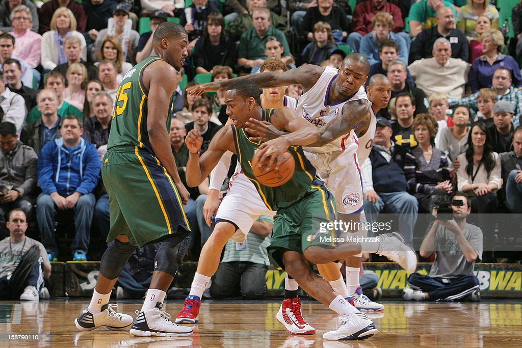 <a gi-track='captionPersonalityLinkClicked' href=/galleries/search?phrase=Alec+Burks&family=editorial&specificpeople=6834208 ng-click='$event.stopPropagation()'>Alec Burks</a> #10 of the Utah Jazz drives against <a gi-track='captionPersonalityLinkClicked' href=/galleries/search?phrase=Jamal+Crawford&family=editorial&specificpeople=201851 ng-click='$event.stopPropagation()'>Jamal Crawford</a> #11 of the Los Angeles Clippers at Energy Solutions Arena on December 28, 2012 in Salt Lake City, Utah.