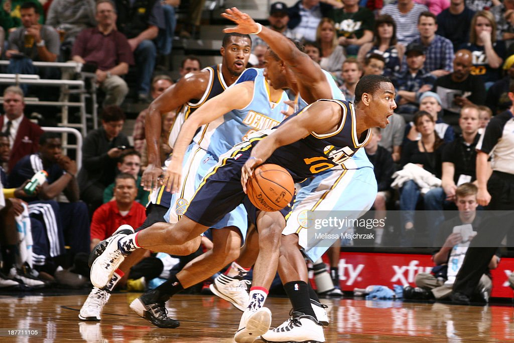 Alec Burks #10 of the Utah Jazz drives against the Denver Nuggets at EnergySolutions Arena on November 11, 2013 in Salt Lake City, Utah.