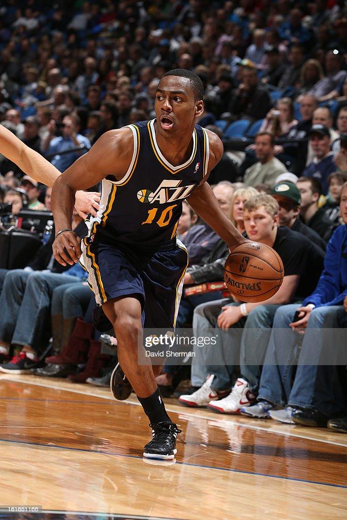 Alec Burks #10 of the Utah Jazz drives against the Minnesota Timberwolves on February 13, 2013 at Target Center in Minneapolis, Minnesota.