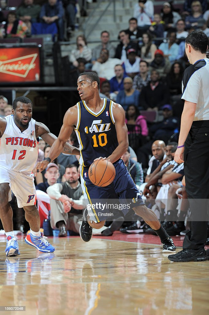 Alec Burks #10 of the Utah Jazz drives against Will Bynum #12 of the Detroit Pistons on January 12, 2013 at The Palace of Auburn Hills in Auburn Hills, Michigan.