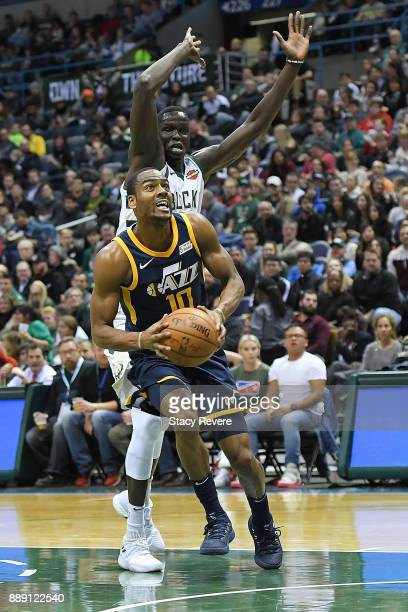 Alec Burks of the Utah Jazz drives around Thon Maker of the Milwaukee Bucks during the first half of a game at the Bradley Center on December 9 2017...