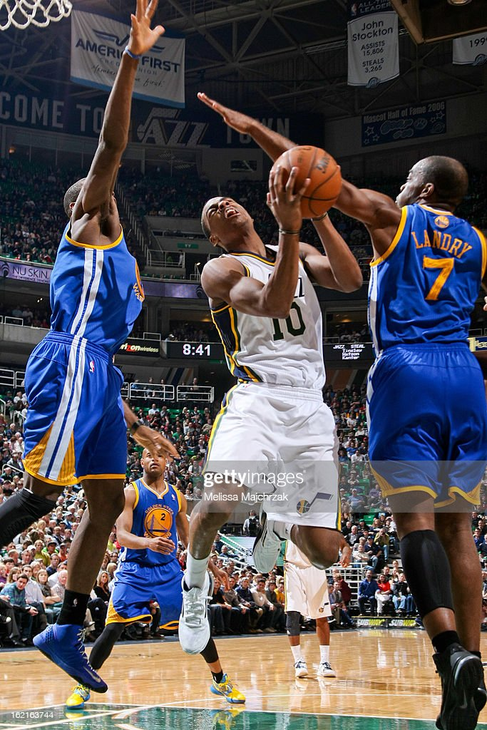 Alec Burks #10 of the Utah Jazz drives to the basket against Carl Landry #7 of the Golden State Warriors at Energy Solutions Arena on February 19, 2013 in Salt Lake City, Utah.