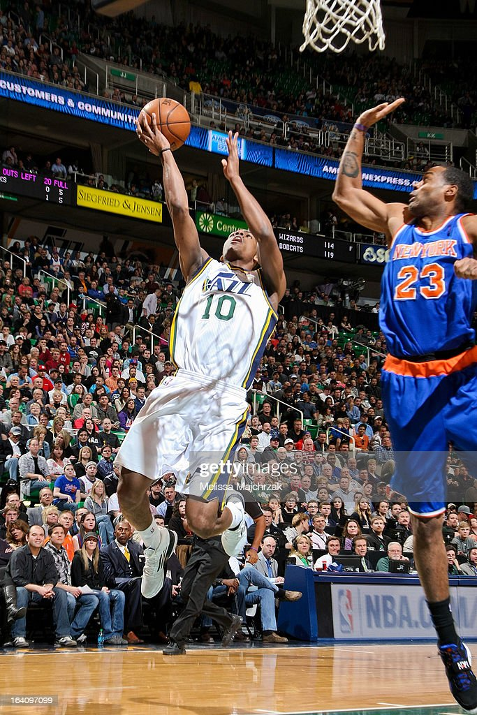 Alec Burks #10 of the Utah Jazz drives to the basket against Marcus Camby #23 of the New York Knicks at Energy Solutions Arena on March 18, 2013 in Salt Lake City, Utah.
