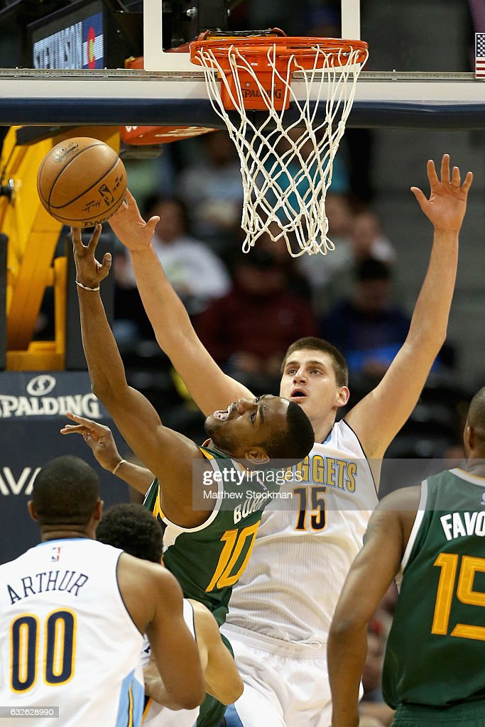 Alec Burks #10 of the Utah Jazz drives to the basket against Nikola Jokic #15 of the Denver Nuggets at the Pepsi Center on January 24, 2017 in Denver, Colorado.