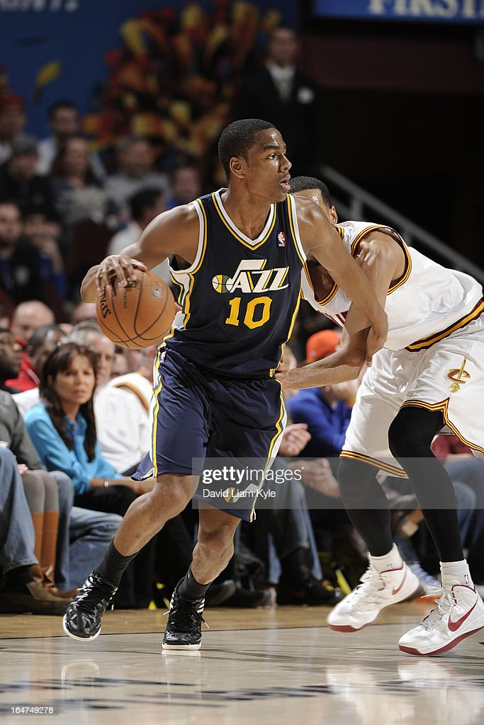 <a gi-track='captionPersonalityLinkClicked' href=/galleries/search?phrase=Alec+Burks&family=editorial&specificpeople=6834208 ng-click='$event.stopPropagation()'>Alec Burks</a> #10 of the Utah Jazz drives to the basket against the Cleveland Cavaliers at The Quicken Loans Arena on March 6, 2013 in Cleveland, Ohio.