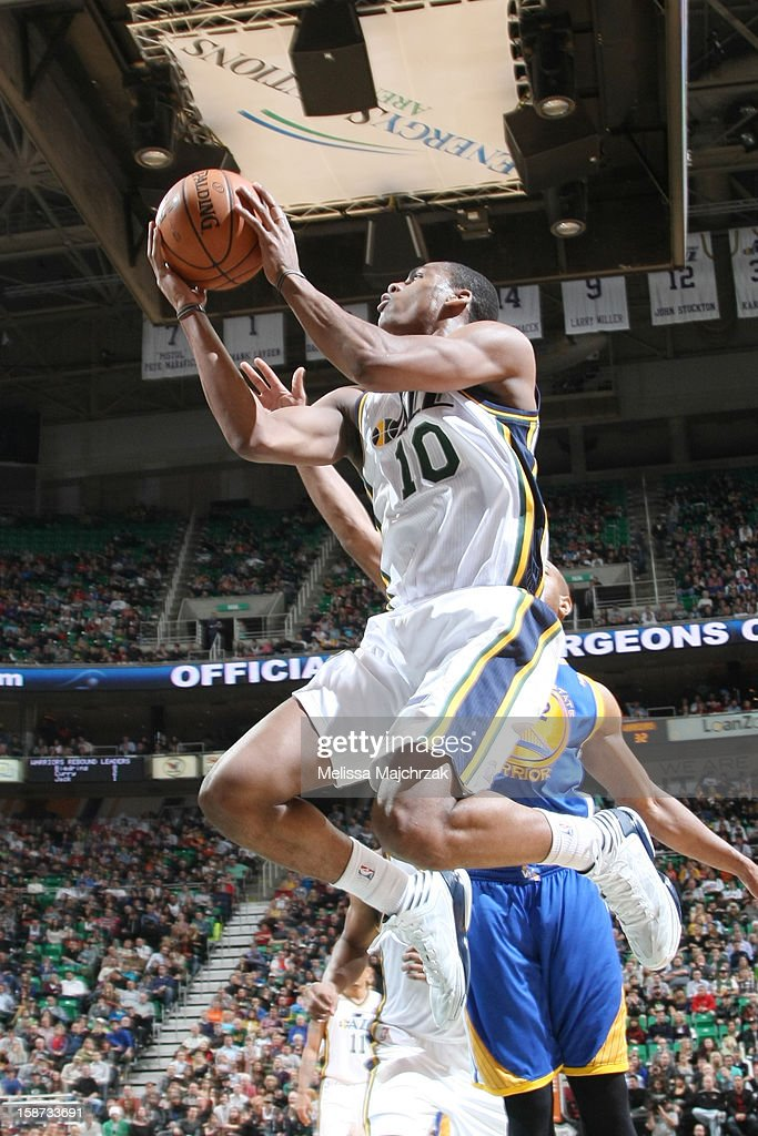 <a gi-track='captionPersonalityLinkClicked' href=/galleries/search?phrase=Alec+Burks&family=editorial&specificpeople=6834208 ng-click='$event.stopPropagation()'>Alec Burks</a> #10 of the Utah Jazz drives to the basket against the Golden State Warriors at Energy Solutions Arena on December 26, 2012 in Salt Lake City, Utah.