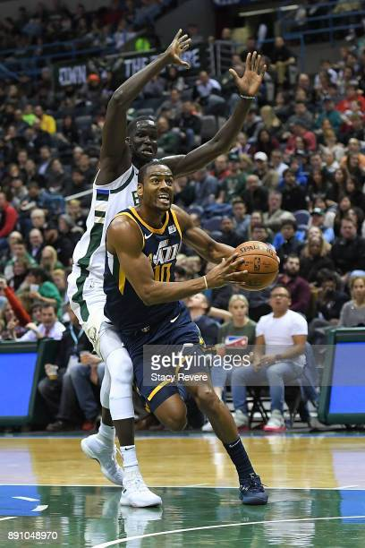 Alec Burks of the Utah Jazz drives to the basket against Thon Maker of the Milwaukee Bucks during a game at the Bradley Center on December 9 2017 in...