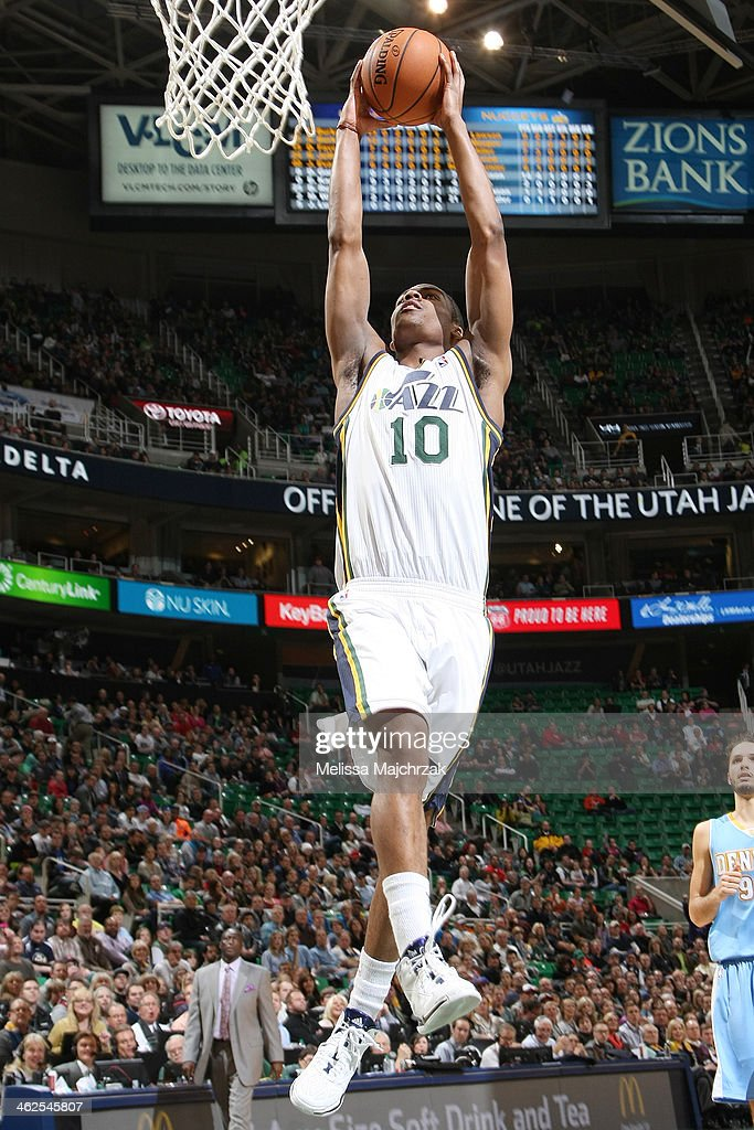 Alec Burks #10 of the Utah Jazz dunks against the Denver Nuggets at EnergySolutions Arena on January 13, 2014 in Salt Lake City, Utah.