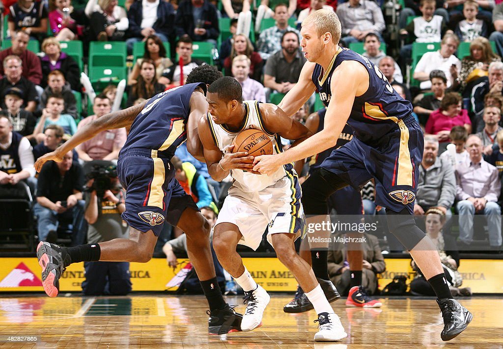 Alec Burks #10 of the Utah Jazz fights for the ball against Greg Stiemsma #34 and Al-Farouq Aminu #0 of the New Orleans Pelicans at EnergySolutions Arena on April 04, 2014 in Salt Lake City, Utah.
