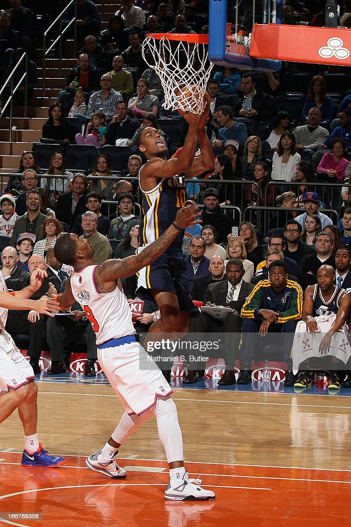 <a gi-track='captionPersonalityLinkClicked' href=/galleries/search?phrase=Alec+Burks&family=editorial&specificpeople=6834208 ng-click='$event.stopPropagation()'>Alec Burks</a> #10 of the Utah Jazz goes to the basket against <a gi-track='captionPersonalityLinkClicked' href=/galleries/search?phrase=J.R.+Smith&family=editorial&specificpeople=201766 ng-click='$event.stopPropagation()'>J.R. Smith</a> #8 of the New York Knicks on March 9, 2013 at Madison Square Garden in New York City.