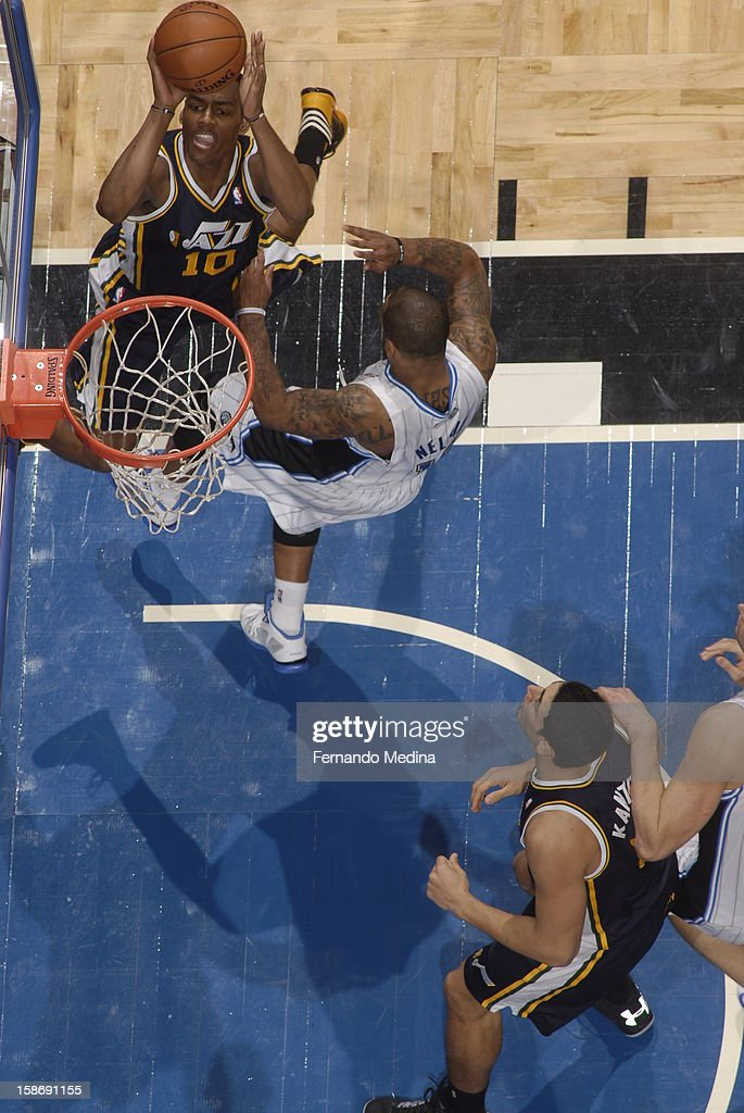 <a gi-track='captionPersonalityLinkClicked' href=/galleries/search?phrase=Alec+Burks&family=editorial&specificpeople=6834208 ng-click='$event.stopPropagation()'>Alec Burks</a> #10 of the Utah Jazz goes up for a short basket against the Orlando Magic during the game on December 23, 2012 at Amway Center in Orlando, Florida.
