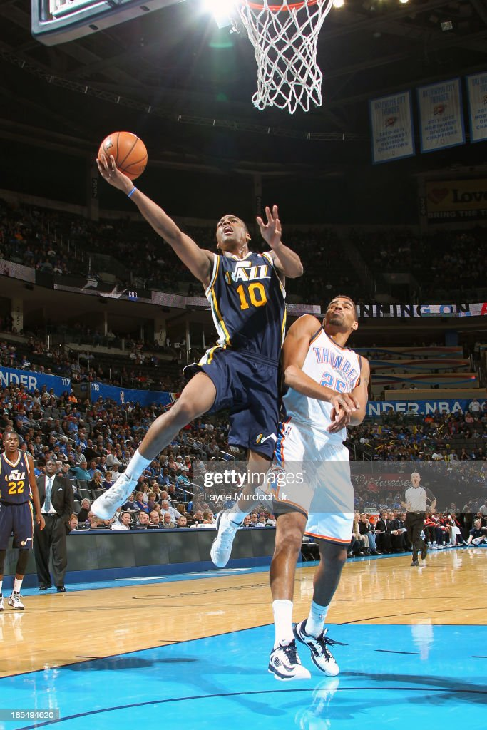 <a gi-track='captionPersonalityLinkClicked' href=/galleries/search?phrase=Alec+Burks&family=editorial&specificpeople=6834208 ng-click='$event.stopPropagation()'>Alec Burks</a> #10 of the Utah Jazz goes up for the layup against the Oklahoma City Thunder during an NBA preseason game on October 20, 2013 at the Chesapeake Energy Arena in Oklahoma City, Oklahoma.