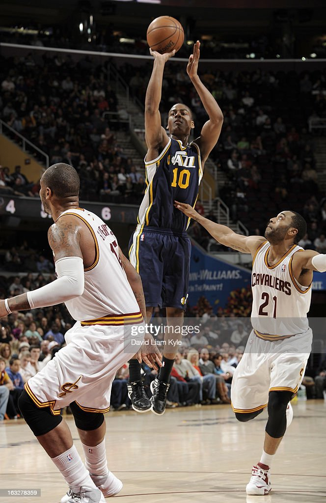 Alec Burks #10 of the Utah Jazz goes up for the shot against Wayne Ellington #21 of the Cleveland Cavaliers at The Quicken Loans Arena on March 6, 2013 in Cleveland, Ohio.