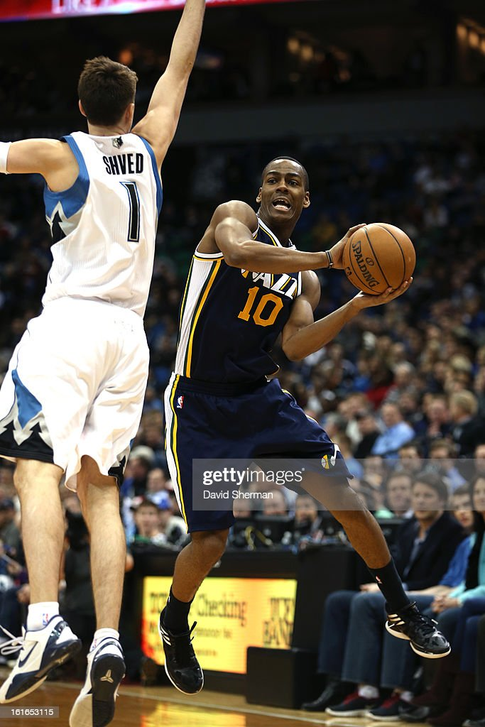 Alec Burks #10 of the Utah Jazz passes the ball against Alexey Shved #1 of the Minnesota Timberwolves on February 13, 2013 at Target Center in Minneapolis, Minnesota.