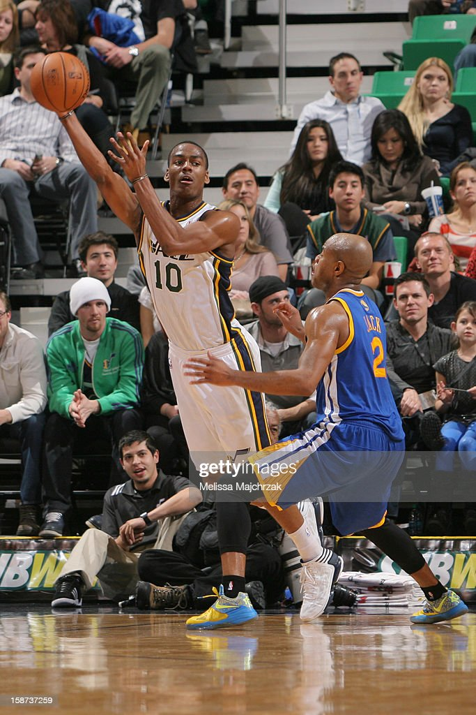 <a gi-track='captionPersonalityLinkClicked' href=/galleries/search?phrase=Alec+Burks&family=editorial&specificpeople=6834208 ng-click='$event.stopPropagation()'>Alec Burks</a> #10 of the Utah Jazz passes the ball against <a gi-track='captionPersonalityLinkClicked' href=/galleries/search?phrase=Jarrett+Jack&family=editorial&specificpeople=208109 ng-click='$event.stopPropagation()'>Jarrett Jack</a> #2 of the Golden State Warriors at Energy Solutions Arena on December 26, 2012 in Salt Lake City, Utah.