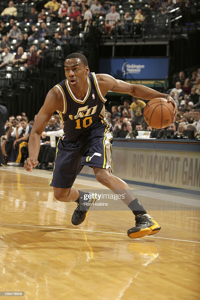 <a gi-track='captionPersonalityLinkClicked' href=/galleries/search?phrase=Alec+Burks&family=editorial&specificpeople=6834208 ng-click='$event.stopPropagation()'>Alec Burks</a> #10 of the Utah Jazz protects the ball during the game between the Indiana Pacers and the Utah Jazz on December 19, 2012 at Bankers Life Fieldhouse in Indianapolis, Indiana.