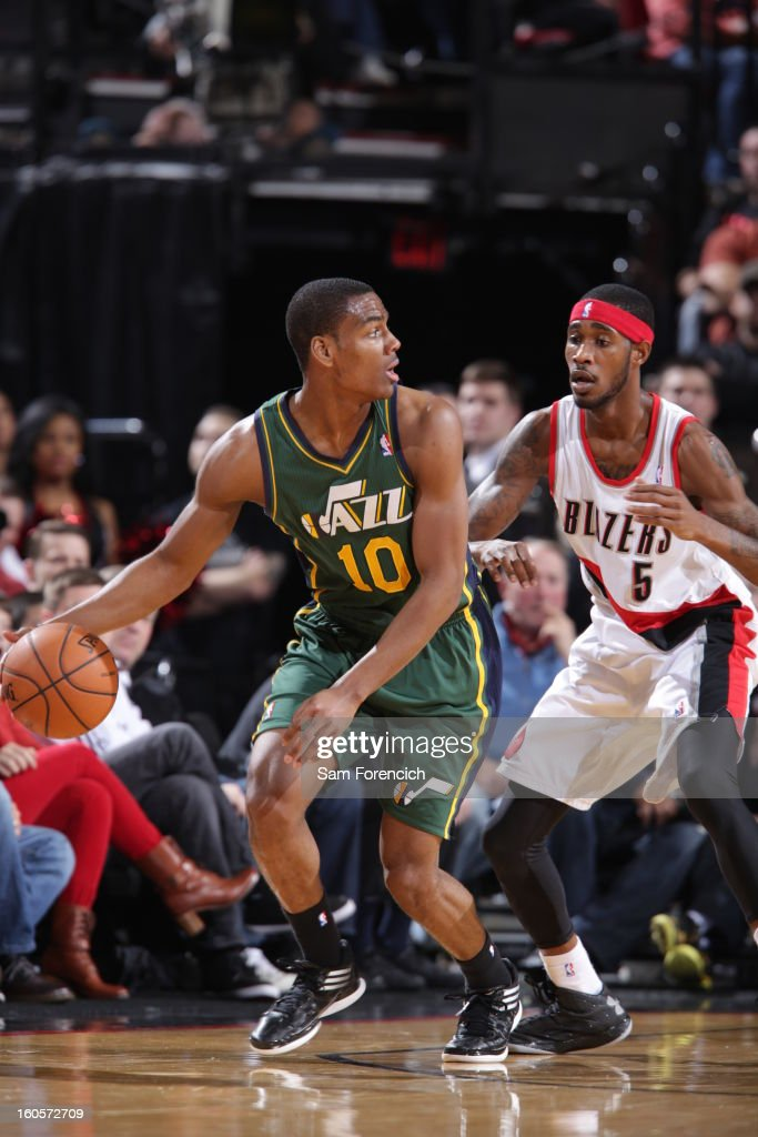 Alec Burks #10 of the Utah Jazz protects the ball from Will Barton #5 of the Portland Trail Blazers during the game between the Utah Jazz and the Portland Trail Blazers on February 2, 2013 at the Rose Garden Arena in Portland, Oregon.