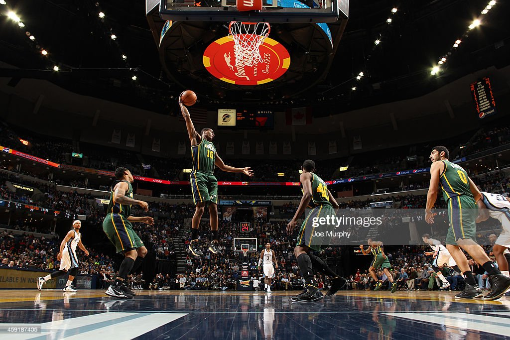 Alec Burks #10 of the Utah Jazz rebounds against the Memphis Grizzlies on December 23, 2013 at FedExForum in Memphis, Tennessee.