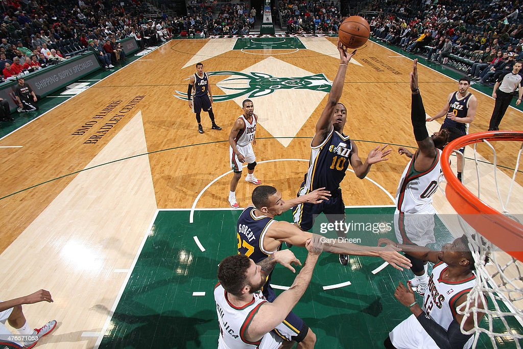 Alec Burks #10 of the Utah Jazz shoots against O.J. Mayo #00 of the Milwaukee Bucks on March 3, 2014 at the BMO Harris Bradley Center in Milwaukee, Wisconsin.