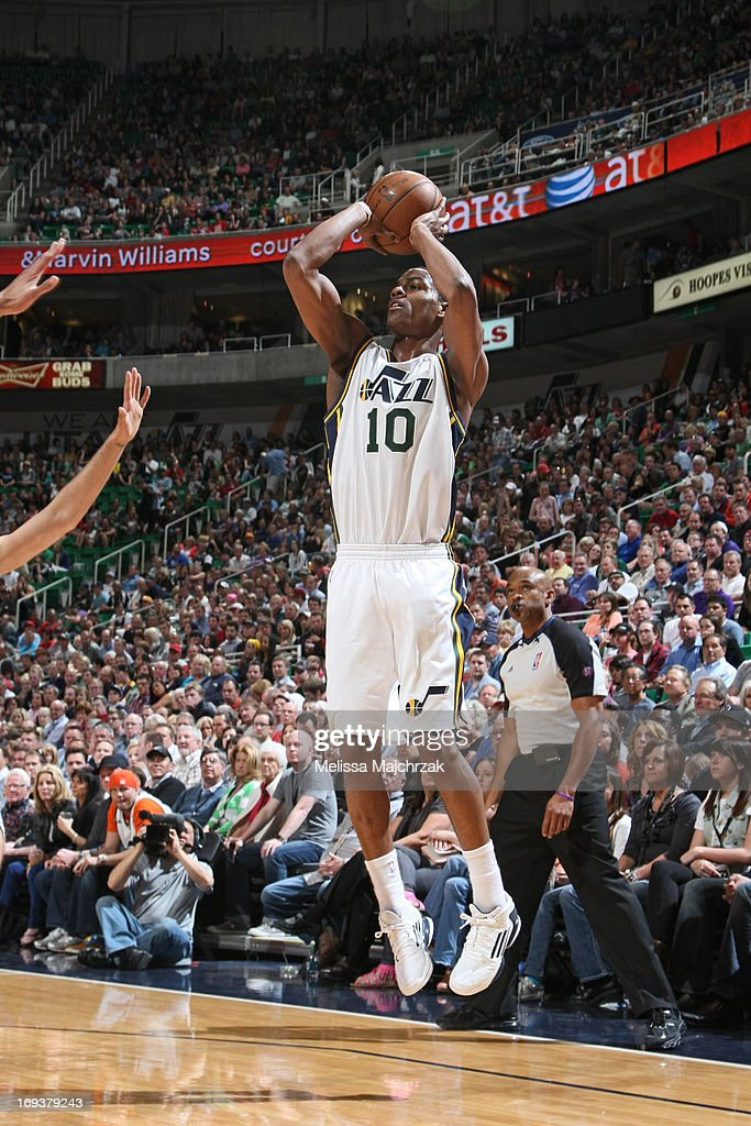 <a gi-track='captionPersonalityLinkClicked' href=/galleries/search?phrase=Alec+Burks&family=editorial&specificpeople=6834208 ng-click='$event.stopPropagation()'>Alec Burks</a> #10 of the Utah Jazz shoots the ball against the Denver Nuggets at Energy Solutions Arena on April 3, 2013 in Salt Lake City, Utah.