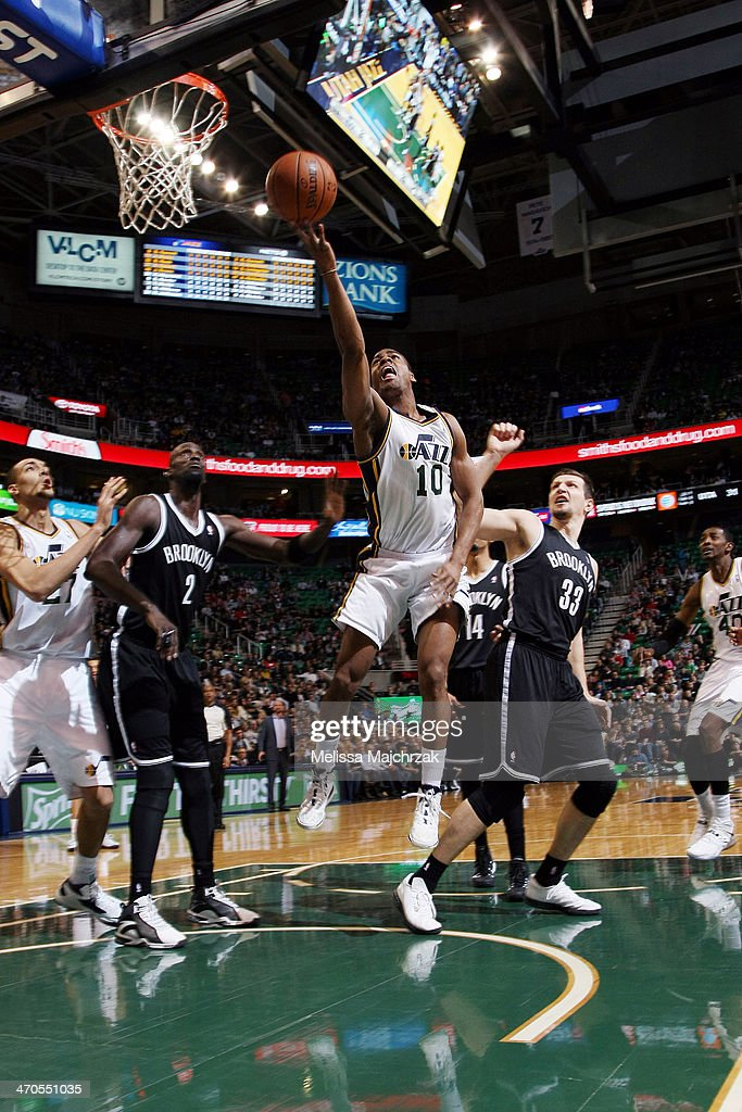 <a gi-track='captionPersonalityLinkClicked' href=/galleries/search?phrase=Alec+Burks&family=editorial&specificpeople=6834208 ng-click='$event.stopPropagation()'>Alec Burks</a> #10 of the Utah Jazz shoots the Brooklyn Nets at EnergySolutions Arena on February 19, 2014 in Salt Lake City, Utah.