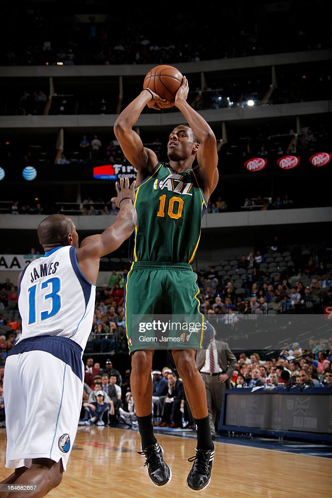 <a gi-track='captionPersonalityLinkClicked' href=/galleries/search?phrase=Alec+Burks&family=editorial&specificpeople=6834208 ng-click='$event.stopPropagation()'>Alec Burks</a> #10 of the Utah Jazz takes a shot against the Dallas Mavericks on March 24, 2013 at the American Airlines Center in Dallas, Texas.