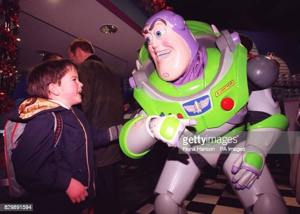 Alec de Sausmarez comes face to face with his hero Buzz Lightyear as he joined the throng of customers battling it out this morning at the Disney...