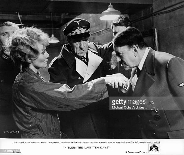 Alec Guinness as Adolf Hitler welcomes test pilot Diane Cilento as Eric Porter looks on in the bunker in a scene from the film 'Hitler The Last Ten...