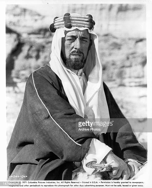 Alec Guinness grabbing his sword in a scene from the film 'Lawrence Of Arabia' 1962