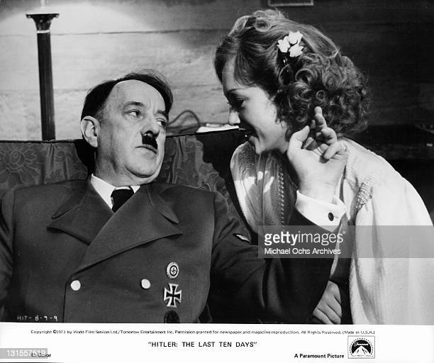 Alec Guinness relaxing with his mistress Doris Kunstmann in a scene from the film 'Hitler The Last Ten Days' 1973