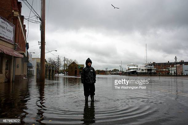 Alec Howard of Arnold Maryland explores the flooded City Dock in Annapolis Maryland on October 30 2012 Most of the parking lot and benches were...