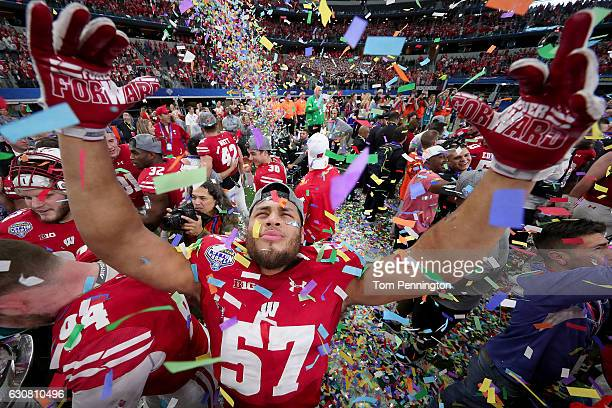 Alec James of the Wisconsin Badgers celebrates after the Wisconsin Badgers beat the Western Michigan Broncos 2416 in the 81st Goodyear Cotton Bowl...