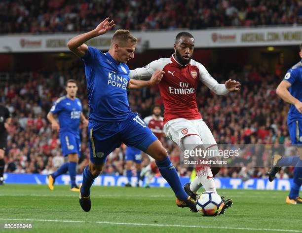 Alec Lacazette of Arsenal takes on MArc Albrighton of Leicester during the Premier League match between Arsenal and Leicester City at Emirates...
