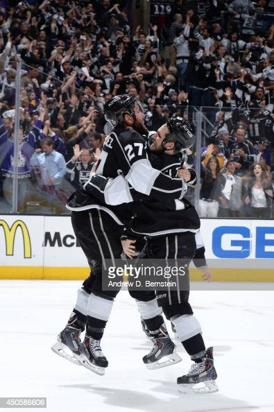 Alec Martinez and Kyle Clifford of the Los Angeles Kings celebrate after Martinez scored the gamewinning goal against the New York Rangers in the...