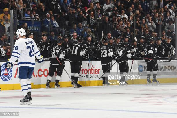 Alec Martinez Anze Kopitar Dustin Brown Michael Cammalleri and Drew Doughty of the Los Angeles Kings celebrate after scoring a goal against the...